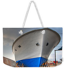 Weekender Tote Bag featuring the photograph a resting boat in Jaffa port by Ron Shoshani