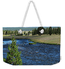 Weekender Tote Bag featuring the photograph A River Runs Through Yellowstone by Laurel Powell