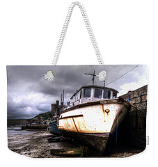 Weekender Tote Bag featuring the photograph A Rough Ride by Doc Braham