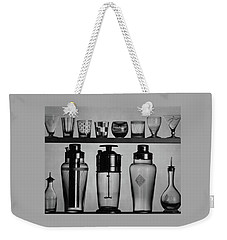 A Row Of Glasses On A Shelf Weekender Tote Bag