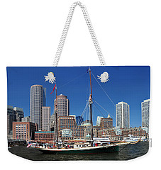Weekender Tote Bag featuring the photograph A Ship In Boston Harbor by Mitchell Grosky