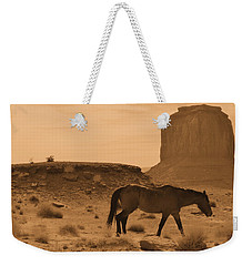 Weekender Tote Bag featuring the photograph A Solitary Soldier by Nadalyn Larsen