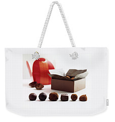 A Still Life Photo Of Gourmet Chocolates Weekender Tote Bag