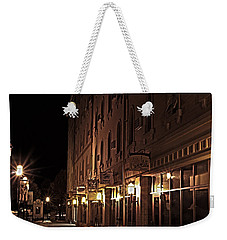 Weekender Tote Bag featuring the photograph A Stroll In The City by Deborah Klubertanz