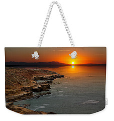 Weekender Tote Bag featuring the photograph A Sunset by Lynn Geoffroy