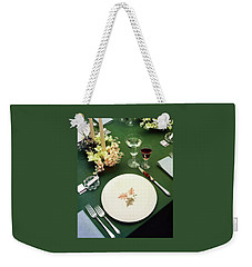 A Table Setting On A Green Tablecloth Weekender Tote Bag