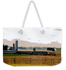 Weekender Tote Bag featuring the photograph A Train Runs Through It by Nina Silver