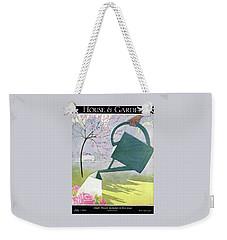 A Watering Can Above Pink Roses Weekender Tote Bag