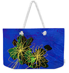Weekender Tote Bag featuring the painting Abstract Flowers On Blue by Ann Powell
