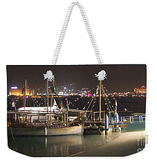 Weekender Tote Bag featuring the photograph Abu Dhabi At Night by Andrea Anderegg