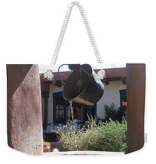 Weekender Tote Bag featuring the photograph Adobe Water Well In New Mexico by Dora Sofia Caputo Photographic Art and Design