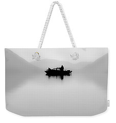 Weekender Tote Bag featuring the photograph Adrift by Aaron Aldrich
