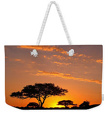 Weekender Tote Bag featuring the photograph African Sunset by Sebastian Musial