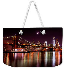 Weekender Tote Bag featuring the photograph Amazing New York Skyline And Brooklyn Bridge With Moon Rising by Mitchell R Grosky