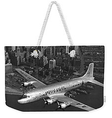 American Dc-6 Flying Over Nyc Weekender Tote Bag