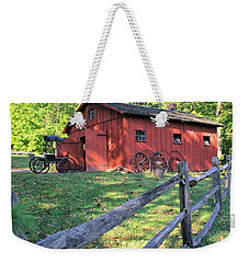 Weekender Tote Bag featuring the photograph Amish Barn Along A Fenceline by Gordon Elwell