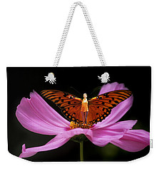 Weekender Tote Bag featuring the photograph Amy The Butterfly by Susan Rovira