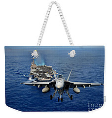 Weekender Tote Bag featuring the photograph An Fa-18 Hornet Demonstrates Air Power. by Paul Fearn