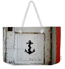 Weekender Tote Bag featuring the photograph Anchor On Old Door by Kathy Barney