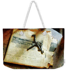 Weekender Tote Bag featuring the photograph Antique Keys On Newspaper by Susan Savad