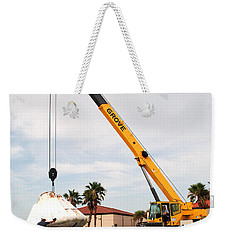 Weekender Tote Bag featuring the photograph Apollo Capsule Going In For Repairs by Science Source