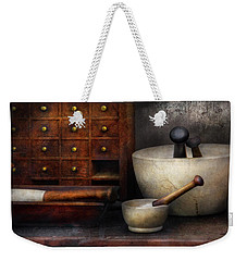 Apothecary - Pestle And Drawers Weekender Tote Bag by Mike Savad