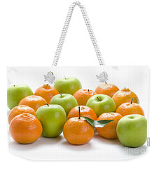 Weekender Tote Bag featuring the photograph Apples And Oranges by Lee Avison