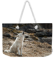 Weekender Tote Bag featuring the photograph Arctic Wolf Howling by Wolves Only