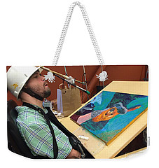 Weekender Tote Bag featuring the photograph Artist Working by Donald J Ryker III