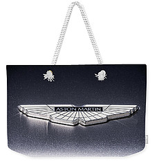 Weekender Tote Bag featuring the digital art Aston Martin Badge by Douglas Pittman