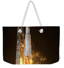 Weekender Tote Bag featuring the photograph Atlas V Rocket Taking Off by Science Source