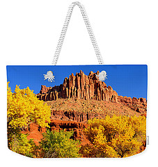Weekender Tote Bag featuring the photograph Autumn Beneath The Castle by Greg Norrell
