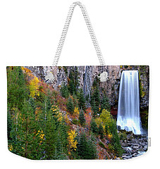 Weekender Tote Bag featuring the photograph Autumn Colors Surround Tumalo Falls by Kevin Desrosiers