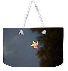 Weekender Tote Bag featuring the photograph Autumn Floating By by Rebecca Davis