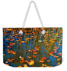 Weekender Tote Bag featuring the photograph Autumn  Floating by Peggy Franz