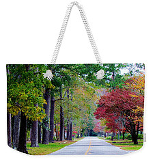 Weekender Tote Bag featuring the photograph Autumn In The Air by Cynthia Guinn