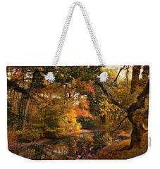 Weekender Tote Bag featuring the photograph Autumn's Edge by Jessica Jenney