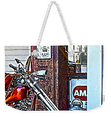 Weekender Tote Bag featuring the photograph Aztec And The Gas Pump by Lesa Fine