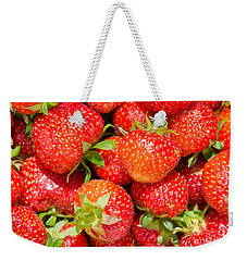 Weekender Tote Bag featuring the photograph Background Of Strawberries by Kennerth and Birgitta Kullman