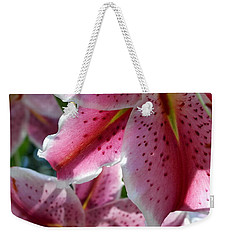 Weekender Tote Bag featuring the photograph Backlit Spotted Daylilies by Michele Myers