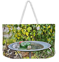 Weekender Tote Bag featuring the photograph Balls In Water by Denise Romano