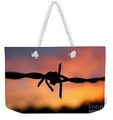 Weekender Tote Bag featuring the photograph Barbed Silhouette by Vicki Spindler