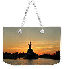 Weekender Tote Bag featuring the photograph Battleship At Sunset by Cynthia Guinn