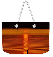 Bayside Ripples - A Heron Takes An Evening Stroll As The Sun Sets Behind The Clouds On The Bay Weekender Tote Bag