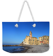 Weekender Tote Bag featuring the photograph beach and church in Camogli by Antonio Scarpi