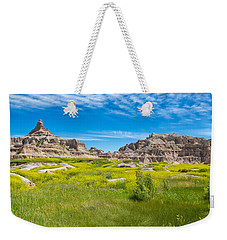 Weekender Tote Bag featuring the photograph Beauty And The Badlands by John M Bailey