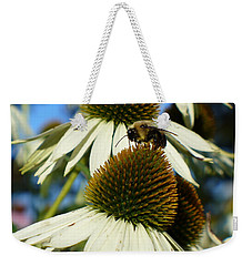 Weekender Tote Bag featuring the photograph Bee On A Cone Flower by Lingfai Leung