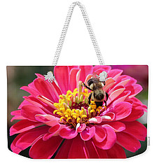 Weekender Tote Bag featuring the photograph Bee On Pink Flower by Cynthia Guinn