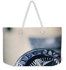 Weekender Tote Bag featuring the photograph Behind The Badge by Trish Mistric