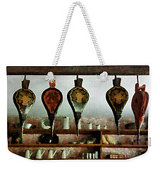 Weekender Tote Bag featuring the photograph Bellows In General Store by Susan Savad